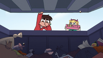 S2E14 Marco Diaz opening a dumpster lid