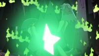 S2E14 Ludo's wand emitting a green glow