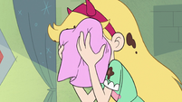 S3E11 Star Butterfly wiping pudding off her face