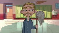 S2E16 Janitor standing in the Fall Hall