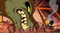 S2E22 Giant wolf monster devouring Marco Diaz