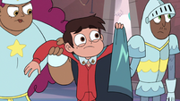 S3E14 Marco Diaz holding up his cape