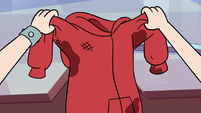 S3E8 Marco Diaz's dirty hoodie in Star's hands