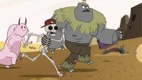 S2E13 Skeleton guy and rock creature rush the truck