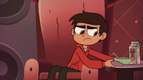 S2E19 Marco Diaz setting the cereal tray aside