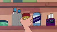 S2E27 Marco Diaz picking up a stick of deodorant