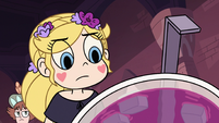 S3E9 Star Butterfly looks closely at the punch bowl