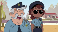 S4E29 Police officer calling out to Barb