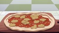 S2E24 Sliced mushrooms falling onto pizza dough