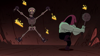 S1E15 Hooded man about to torture skeleton