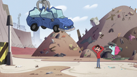 S2E24 Crane claw carrying the crashed car away