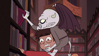 S4E13 Relicor Lucitor pulling on a shelved book