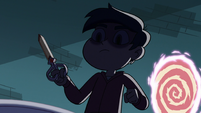 S3E22 Marco standing over Star with scissors