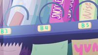 S3E2 Close-up on vending machine's B4 button