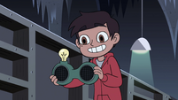 S4E11 Marco holding a relaxation device