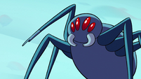 S2E2 Giant spider raises a mandible