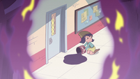 S2E28 Janna pouring grease by classroom door