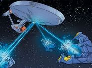 Enterprise fires on Recluse