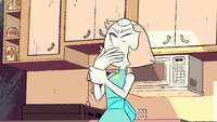 Pearl tries to pull her hand from her mouth.