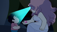 Pearl, as Rose, shines her gem on a confused Steven as she shows him Pink Diamond's gemstone.