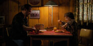 Hopper and El takes breakfast at the cabin