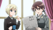 Erica and Trude looking at the newspaper