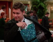 Jeffery holding a Dress