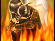 Hans hugs the witch in flames