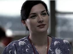 Erica as the nurse in Faith.PNG