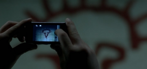 Castiel taking a photograph in 9x18 1