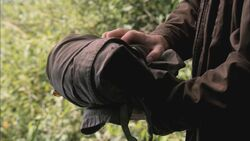Dean holding Castiel's trenchcoat.jpg