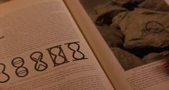 The mark of Chronos, the infinite hourglass.