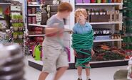 S01E04-Boy wrapping garden hose