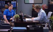 S03E11-Glenns office and monkey puppet