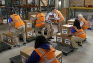 S03E14-Staff lifting boxes