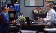 S03E08-Glenn's office and monkey puppet