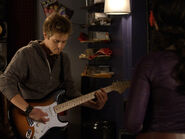 Toby-Kennish playing guitar
