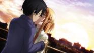 Asuna and Kazuto kissing at sunset in real world