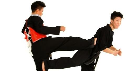 How to Do a Jump Back Kick in Sparring Taekwondo Training