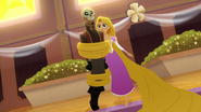 TBEA Rapunzel uses her hair to dodge a skull-masked thug
