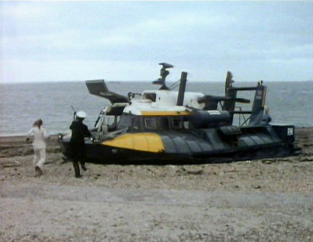 Jo and Hart run for hovercraft - Sea Devils.jpg