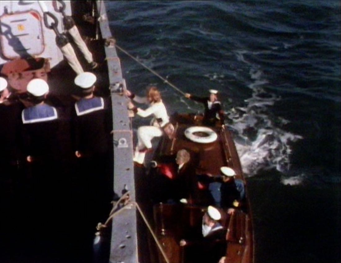 Doctor and Jo climb aboard dive ship.jpg