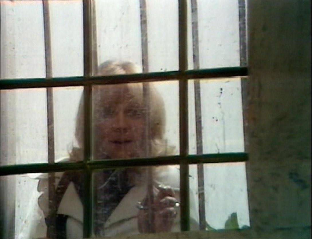 Jo close up prison window - Sea Devils.jpg