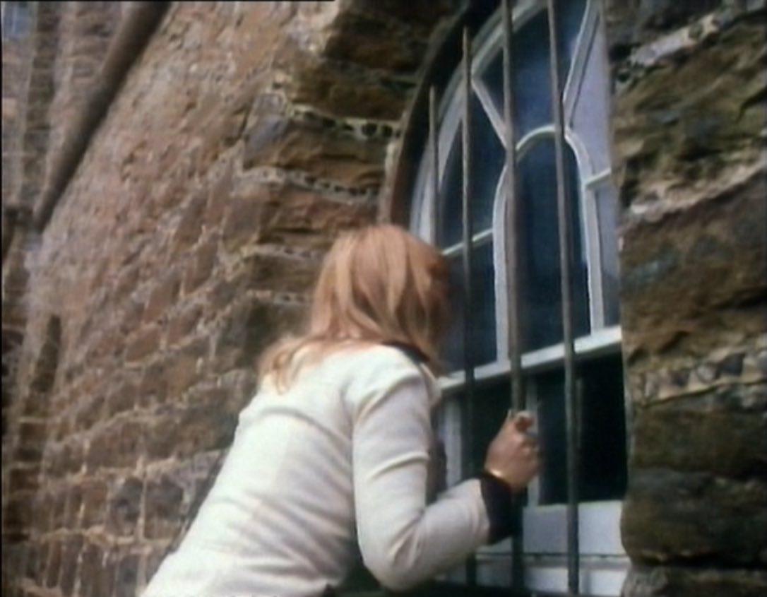 Jo outside prison window - Sea Devils.jpg