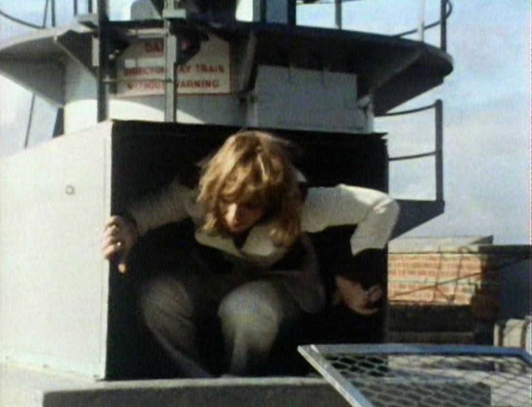 Jo escaping ventilation shaft on roof - Sea Devils.jpg