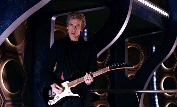 Doctor playing electric guitar in the TARDIS.jpg