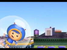 Geo in a bubble floating above the city.png