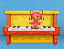 Milli and the piano.png