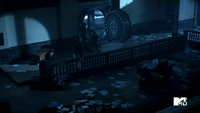 3x02 Boyd and Cora escape from vault.png