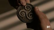 Triskelion coin 1